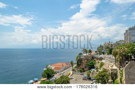 Antalya, Turkey - July 29, 2015: view of the coast of Antalya in the old town area. View of the coast of Antalya, on the background of the sea, the mountain peaks and clouds
