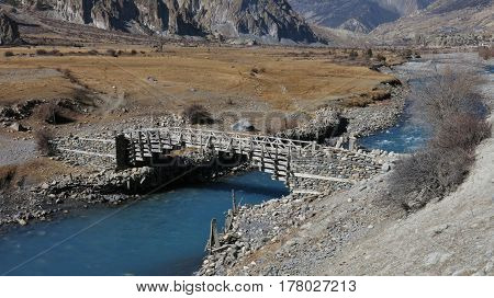 Traditional timber bridge in Manang. Annapurna Conservation Area Nepal.