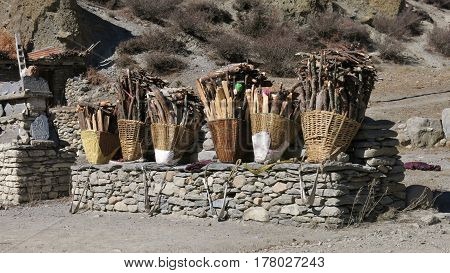 Braided pannier full with firewood put down by local women while having a rest. Scene near Manang Nepal.