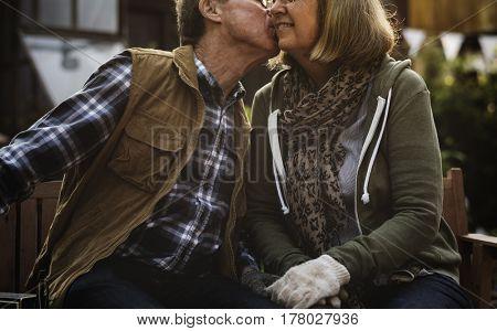 Lovely romantic senior adult couple bonding together