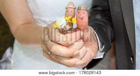 fingers painted with the bride and groom for wedding symbol