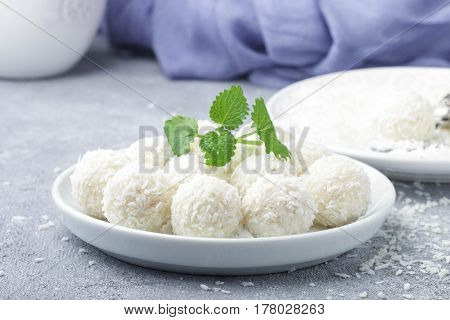 Homemade Coconut Candies In A White Plate On The Table. Sweets. Selective Focus