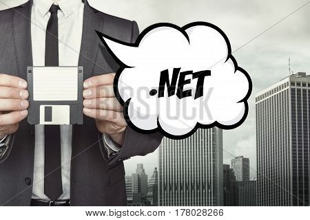 .NET text on speech bubble with businessman holding diskette