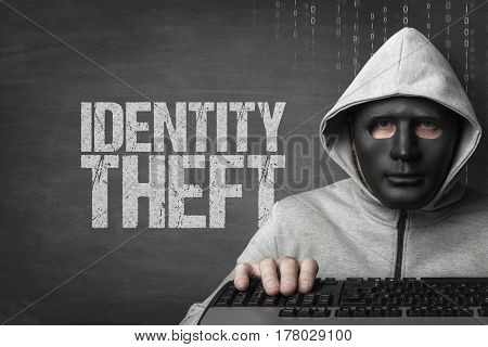 Identity theft piracy text on blackboard with hacker