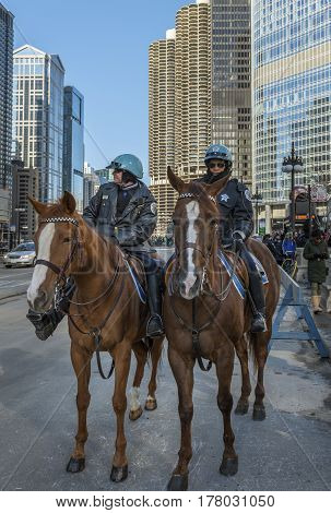 Chicago Illinois 15 March 2014 - Police Department Mounted Patrol watching over the crowds during Saint Patric Day cellebration downtown Chicago.