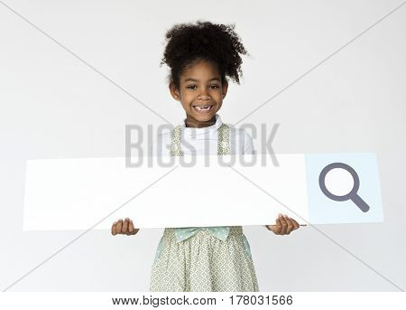 Kid holding search bar icon for studio shoot