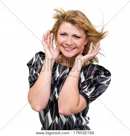 portrait of a happy young woman with flying hair on white background