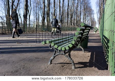 people walk in the Park a Sunny day spring shop girl man baby stroller trees Saint-Petersburg Russia