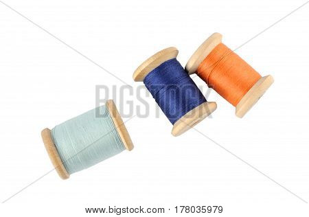 A wooden reels of thread on white background