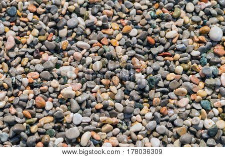 Small rocky cover the sea coast. Texture background