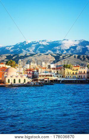 historical houses and Aegan sea at sunny day, Chania, Crete, Greece, retro toned