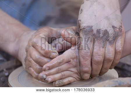 Pottery making, close up shot on hands