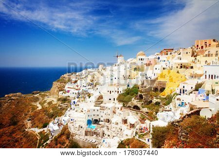 skyline of Oia, traditional white greek village of Santorini, Greece, retro toned