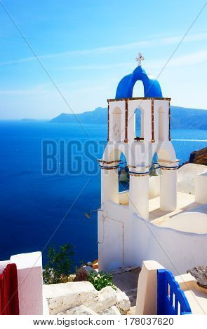 view of caldera with blue sea and belfry, Oia, Santorini, retro toned