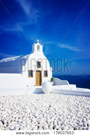 beautiful details of Santorini island - typical white house with blue sea and sky, Greece, retro toned