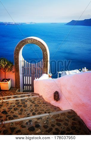 stairs and gate against volcano caldera, beautiful details of Santorini island, Greece, retro toned