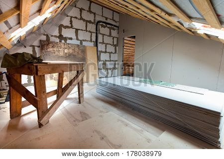 Interior of apartment with materials during under renovation remodeling and construction. (preparing to build walls from gypsum plasterboard)
