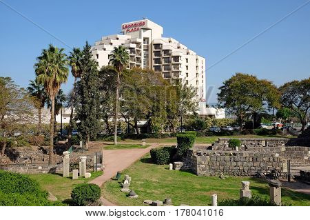 TIBERIAS ISRAEL - FEBRUARY 26 2017: Archaeological Park and Leonardo Plaza Hotel in the Old Town of Tiberias