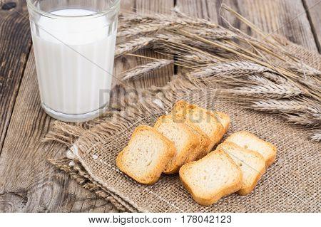 Crispy wheat crunches on wood. Studio Photo