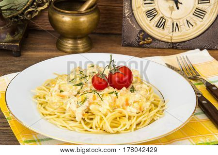 Spaghetti with creamy gravy on plate. Studio Photo