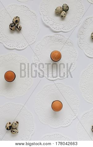 Selection of Eggs on White Table Covered with Vintage Doilies