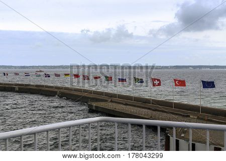 HELSINGBORG, SWEDEN - JUNE 29, 2016: These are the European flags that are installed in the city port opposite the seabed of the Danish coast.