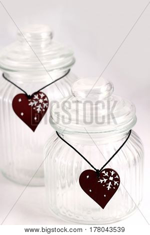 Christmas Glass Jars With Red Wooden Hearts On White Background
