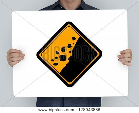 Studio Shoot Holding Banner with Rockfall Beware Sign