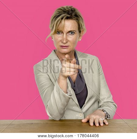 Businesswoman in a studio with wooden table