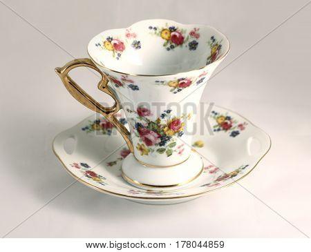 Porcelain Tea Cup With Flower Ornament. Baroque Luxurious Design