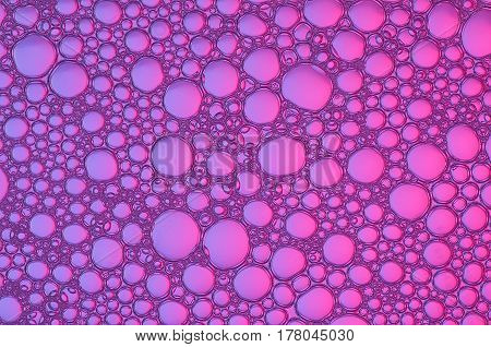 background of colored bubbles located on the surface of the water