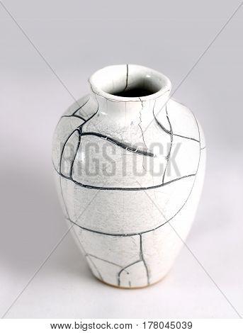 Beautiful Old Vase With Cracks In Studio Shot