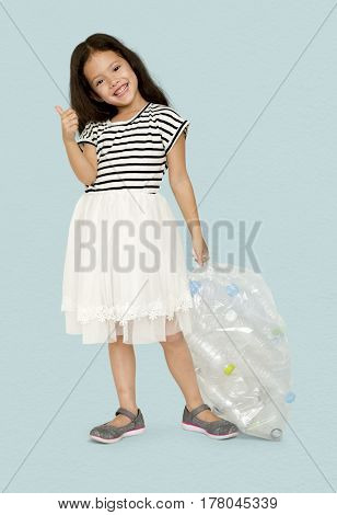 Little Girl Holding Separate Plastic Bottles Studio Portrait