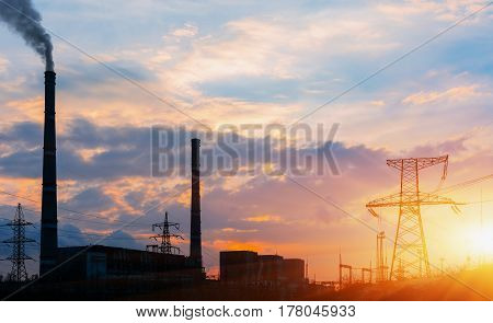 Thermoelectric station generating smokes at the sunset