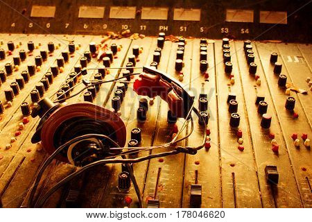 Old Dusty Retro Vintage Mixer And Headphones In Sepia