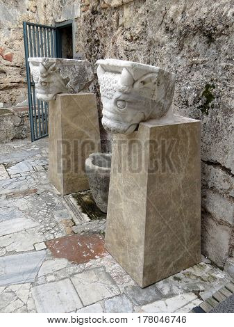 Ancient marble statue of bovine animals on the ruins of the ancient city of Side