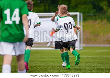 Kids Soccer Players Goal Celebration. Happy Children Playing Football Match. Young Boys on Sports Field