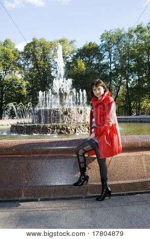 The Girl In A Red Raincoat