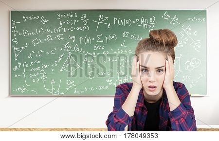 Stressed Teen Girl And Formulas On Blackboard