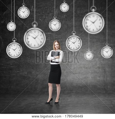 Woman With Folder And Many Clocks