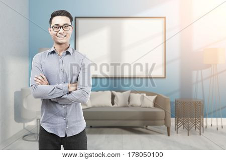 Asian Man In Glasses In Blue Room With Whiteboard