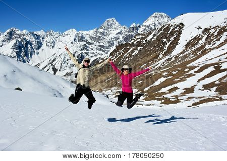 Happy young couple jumping in the Himalaya mountains. Way to the Cho-La pass Everest base camp trek Nepal