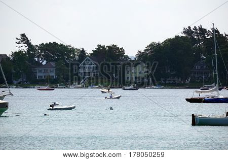 HARBOR SPRINGS, MICHIGAN / UNITED STATES - AUGUST 4, 2016: Sailboats and yachts are moored in the Harbor Springs Yacht Basin.