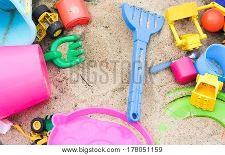 Colorful Toys In The Sandbox. Happy Childhood, Way To Spend Time.