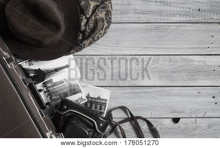 Man's hat and retro accessories for travel on a white painted wooden surface