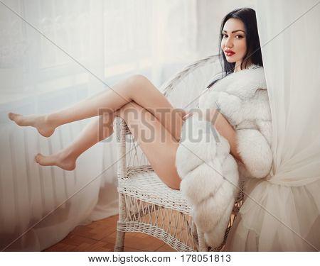 Sexy beautiful brunette girl in underclothes in her bedroom
