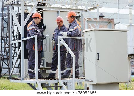Repair team of electricians repair electrical equipment. Power station