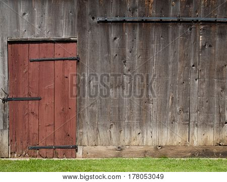 Old barn wall with red door and copy space