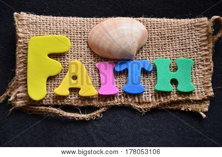 word faith on a  abstract colorful background