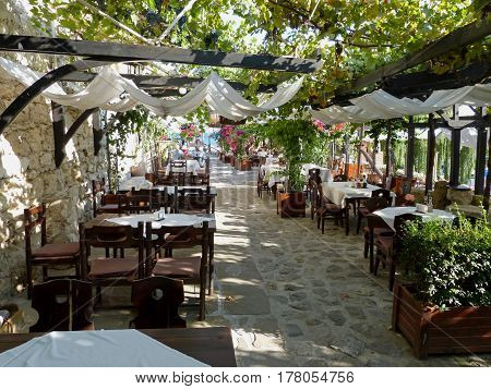 A restaurant with vineyard on the walls of the ancient town of Nesebar, Bulgaria
